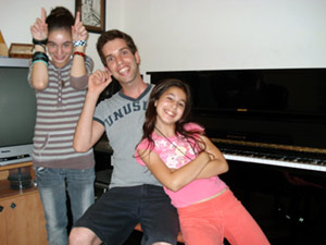 An image of me (David Your piano teacher) with Noam and Ariel, two of my students.)