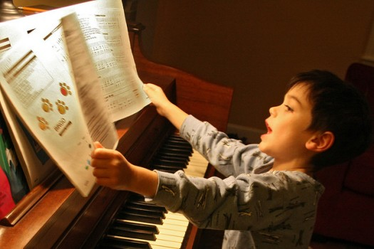An image of a child learning piano