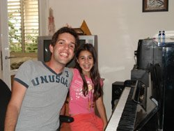Me (David) and Ariel (My Piano Student) next to the piano.