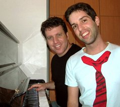 Ido and Me next to the piano creating online piano lessons for you.