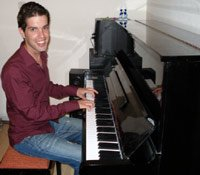 An image of me (David) next to the piano.